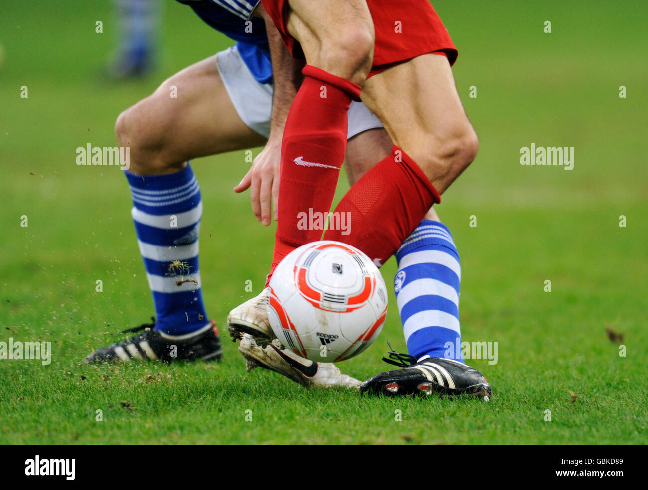 Players legs in a battle for the ball, FC Schalke 04, S04 - SC Freiburg 1-0, Bundesliga federal league, Veltins - Stock Image