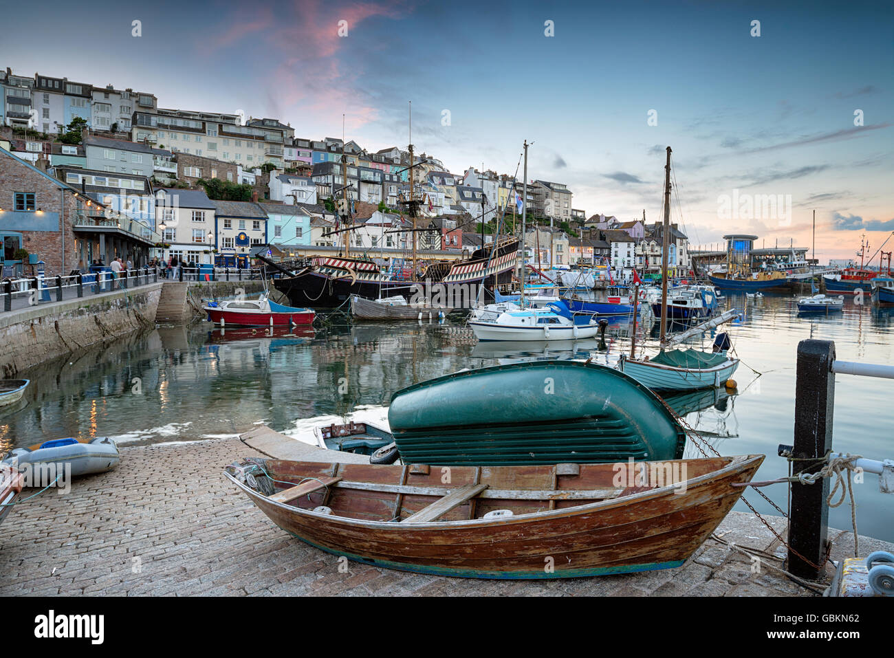 Dusk at Brixham harbour an historic fishing port in the Torbay district on the south coast of Devon - Stock Image