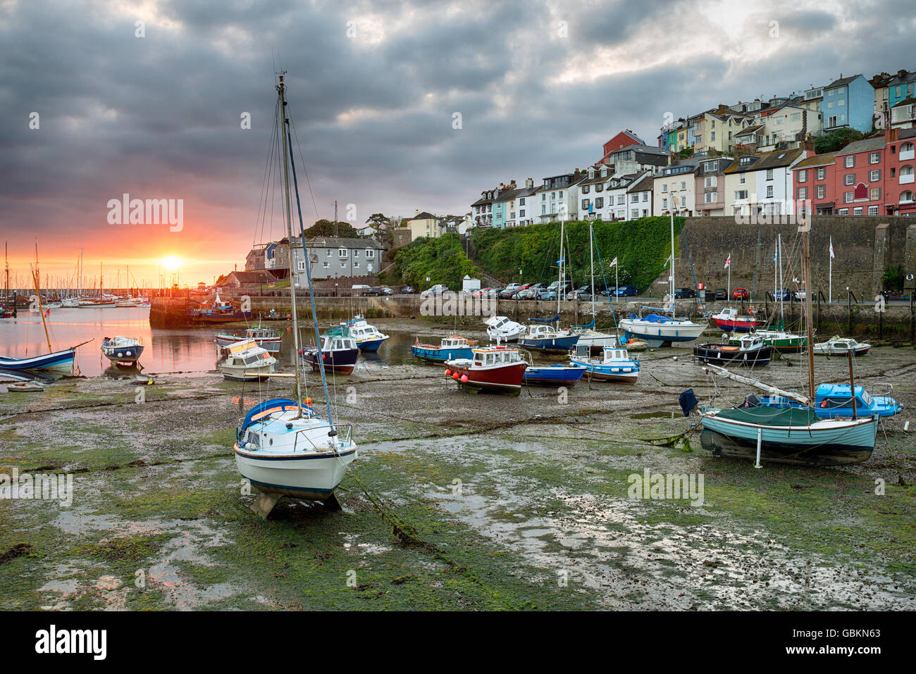 Sunrise over boats in the harbour at Brixham on the south coast of Devon - Stock Image