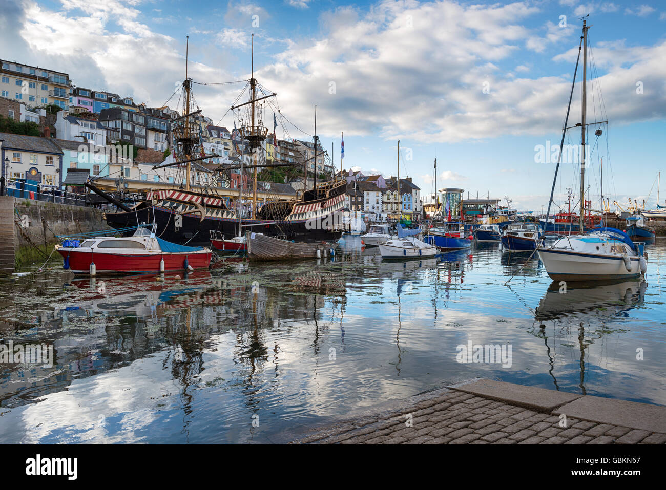 Boats in the harbour at Brixham an historic fishing port in Torbay on the south coast of Devon - Stock Image