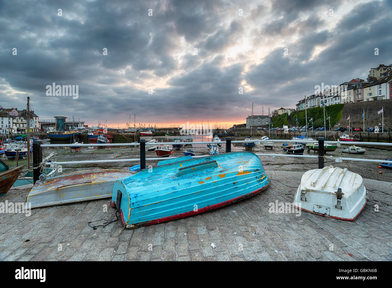 Dramatic sunrise sky over the harbour at Brixham in the Torbay district in Devon - Stock Image
