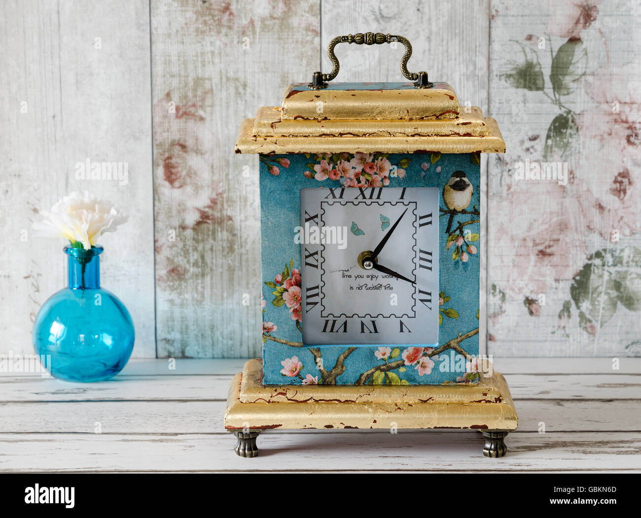 Hanmade decoupage clock with gold leaf gilding and handle Stock Photo