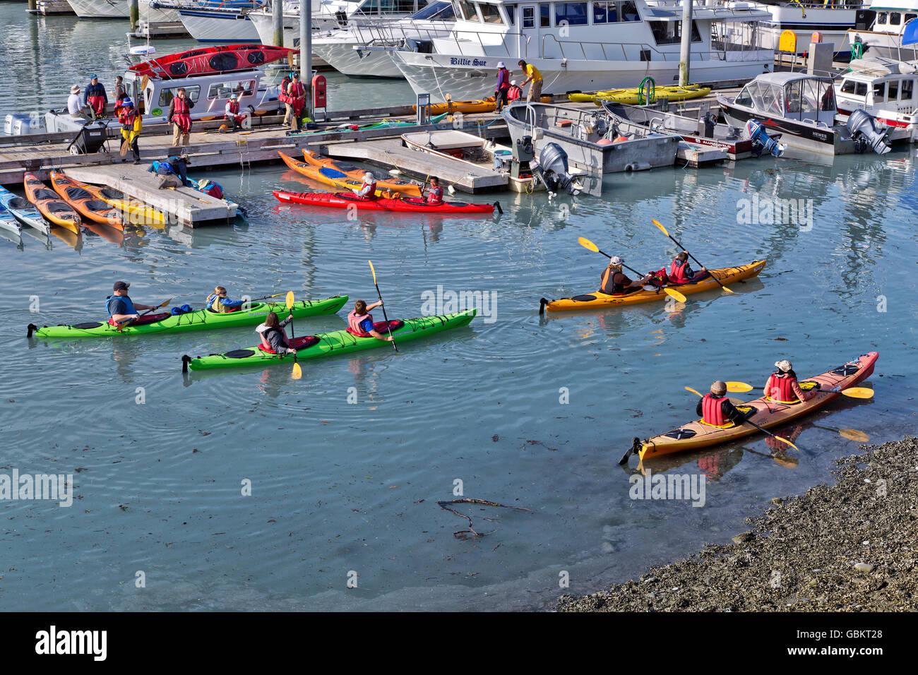 Kayakers, wearing safety gear departing Port of Valdez. - Stock Image