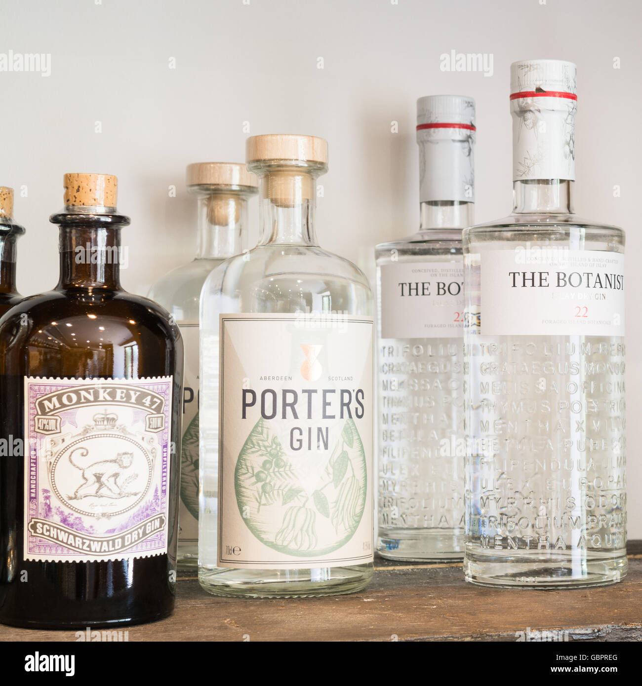 Craft gin for sale - Monkey 47, Porters Gin and The Botanist - Stock Image