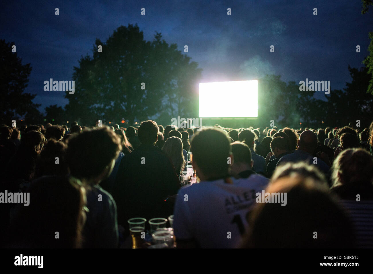 Football supporters at a public viewing of the Euro 2016 semi-final between France and Germany at Tempelhofer Feld - Stock Image