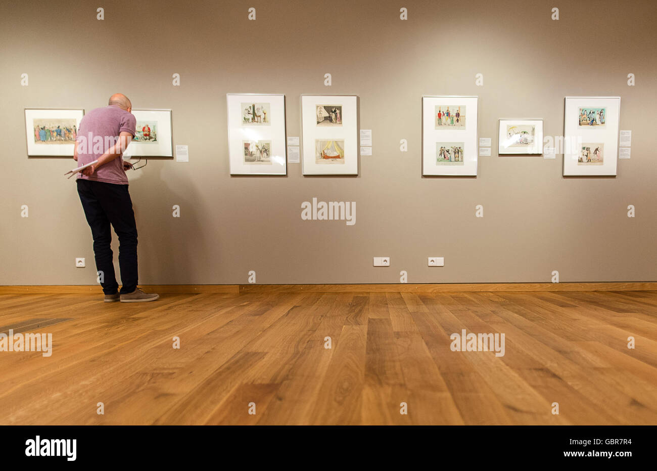 Hanover, Germany. 8th July, 2016. A man looking at 19th century caricatures, during a press conference on the opening Stock Photo