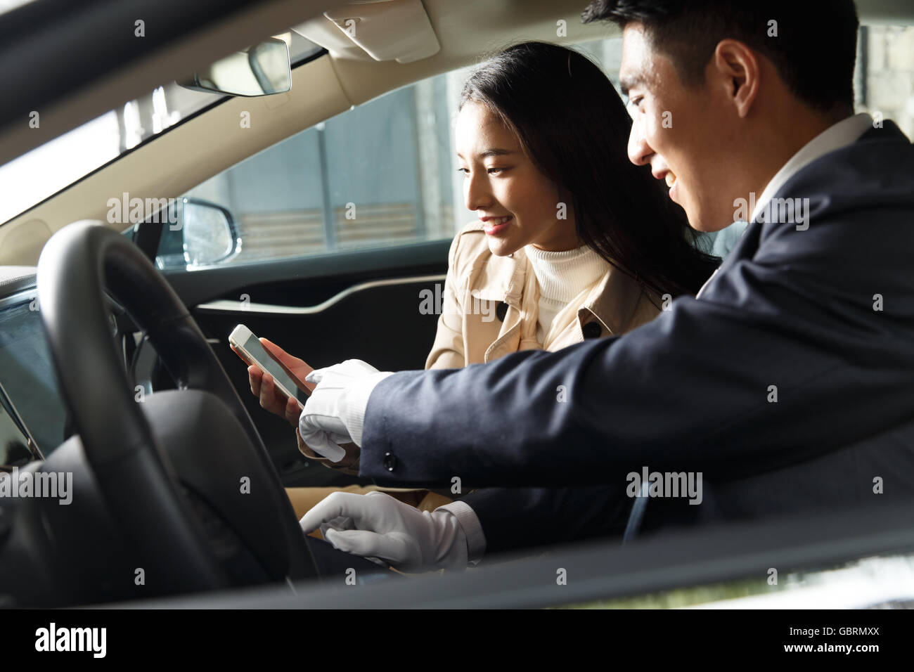 The car driver to a young woman driving Stock Photo