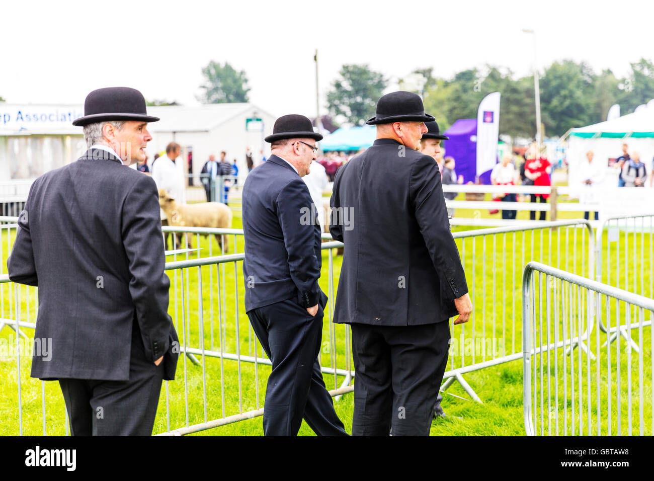 Men in bowler hats wearing bowler hat suits suit posh attire smart smartly dressed UK England GB - Stock Image