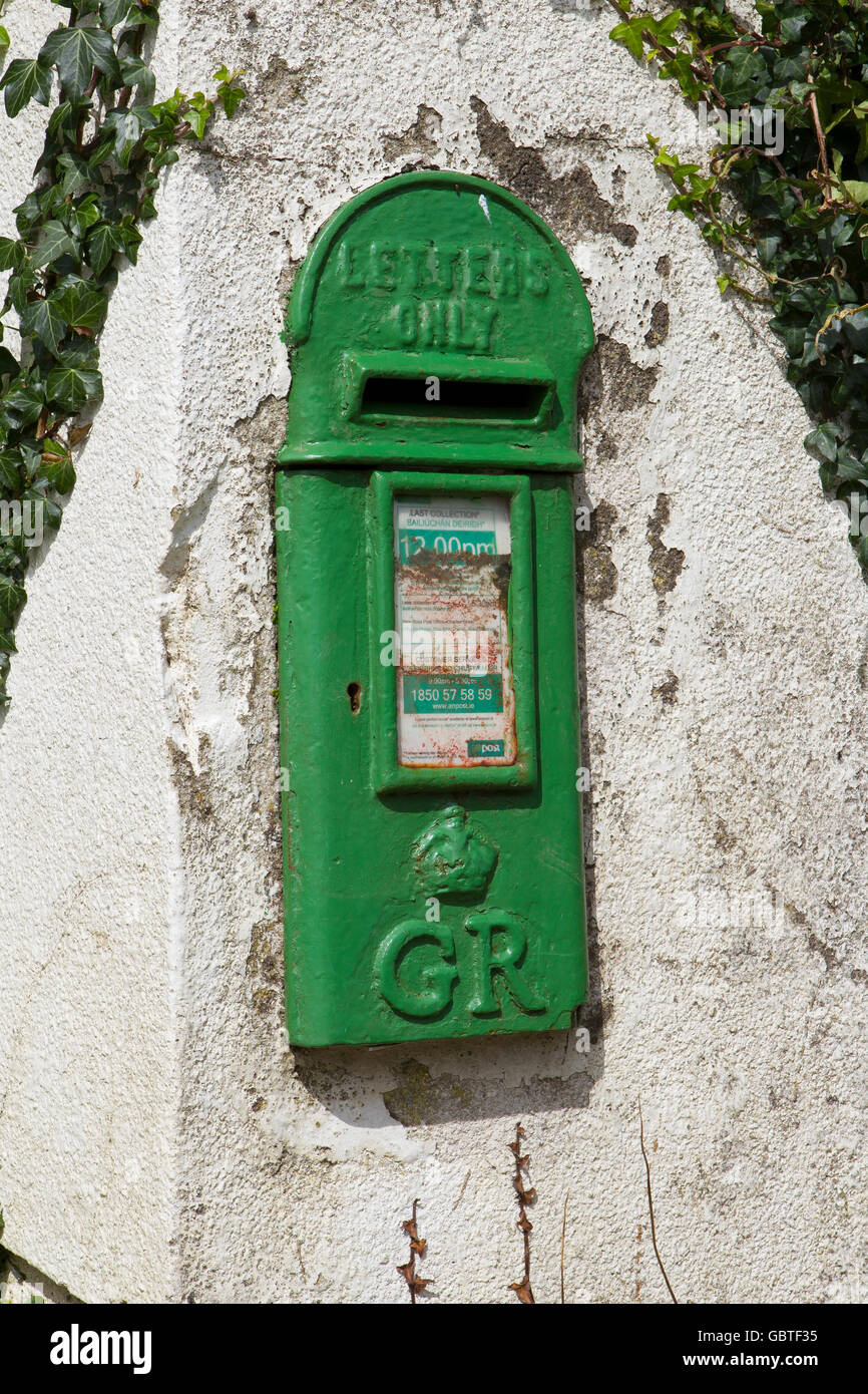 irish green postbox letterbox post letter box - Stock Image
