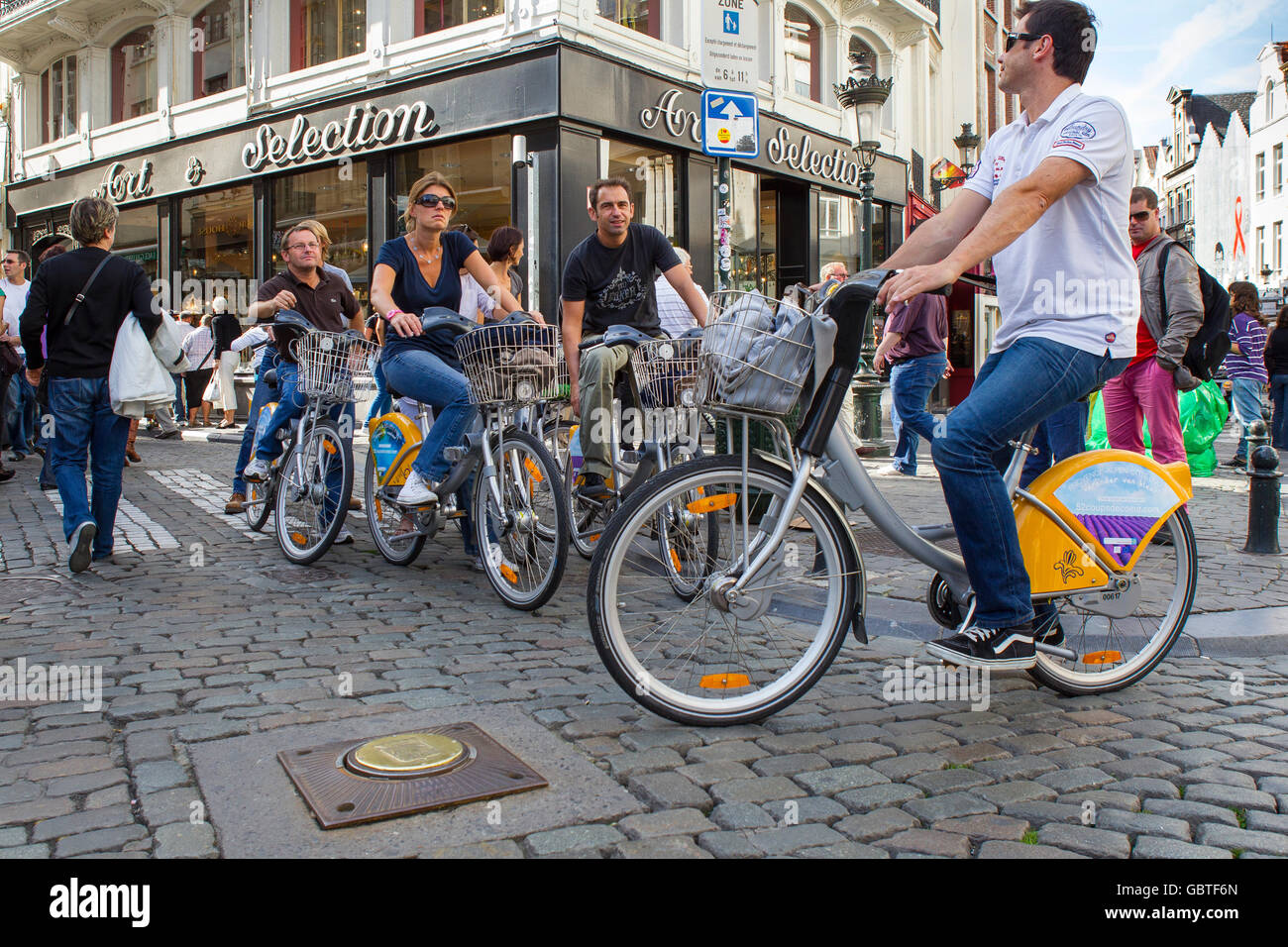 group tourists villo bicycles bikes cycle brussels - Stock Image
