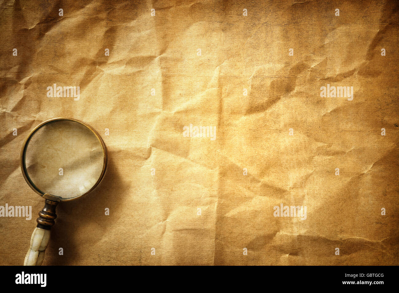 Vintage background with magnifying glass - Stock Image
