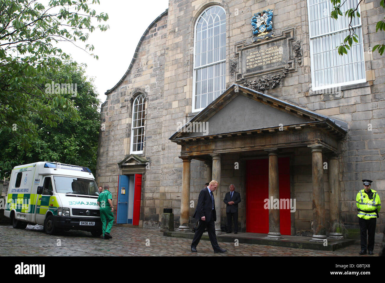 An ambulance arrives at Cannongate Church in Edinburgh, after a female member of the congregation took ill during Stock Photo