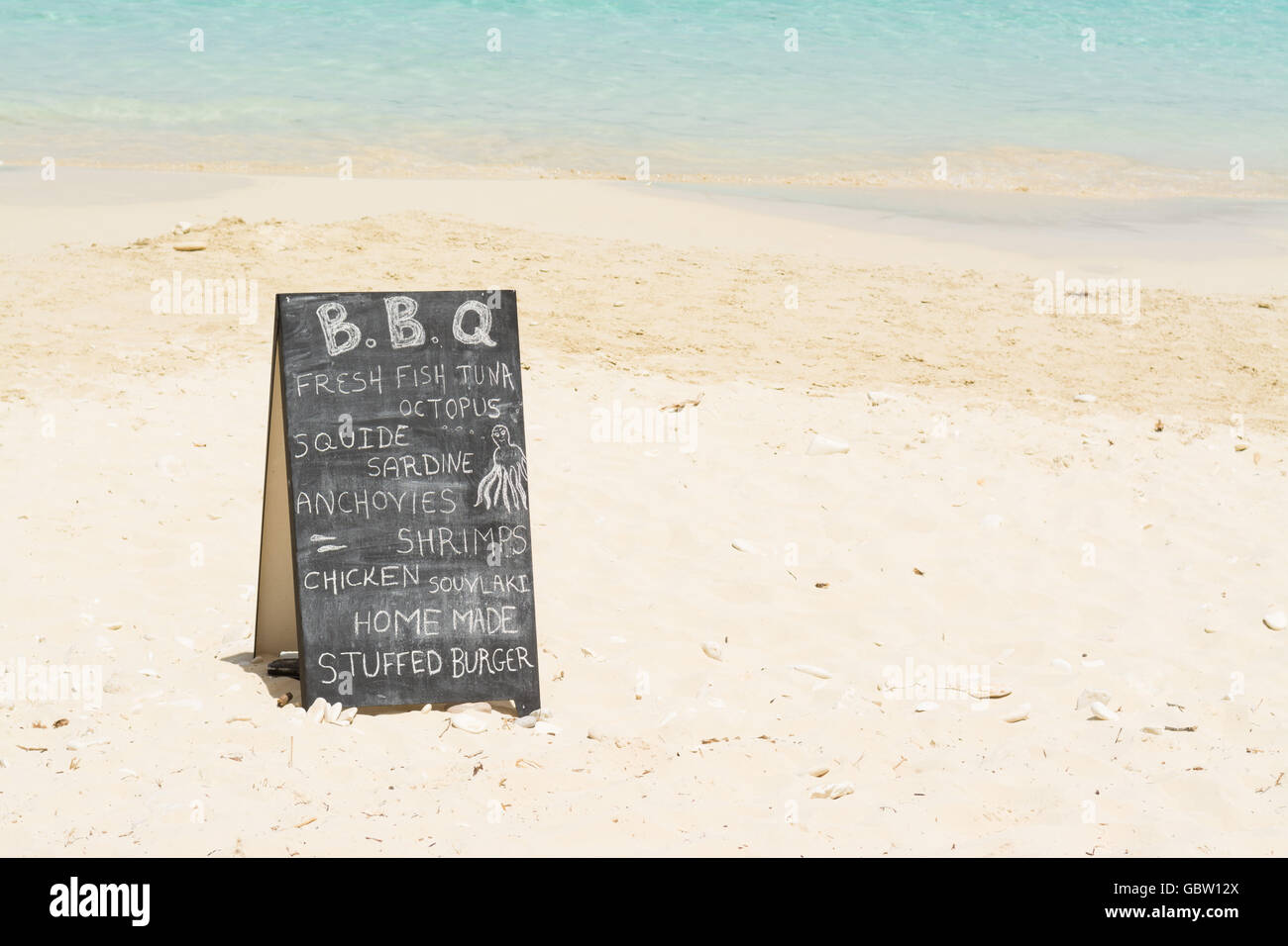 Beach BBQ sign on beach in Antipaxos, Greece - Stock Image