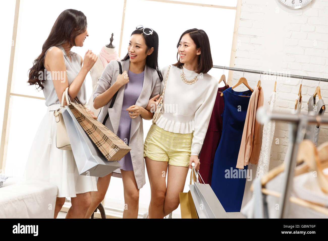 b08dc4f3c7d67 Young women's clothing store shopping in bestie Stock Photo ...