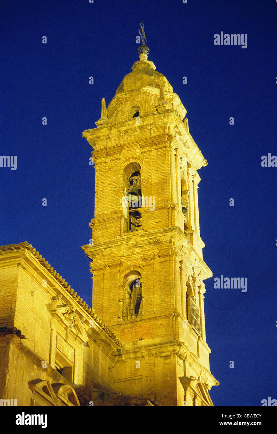Tower of San Agustin church, night view. Antequera, Malaga province, Andalucia, Spain. - Stock Image