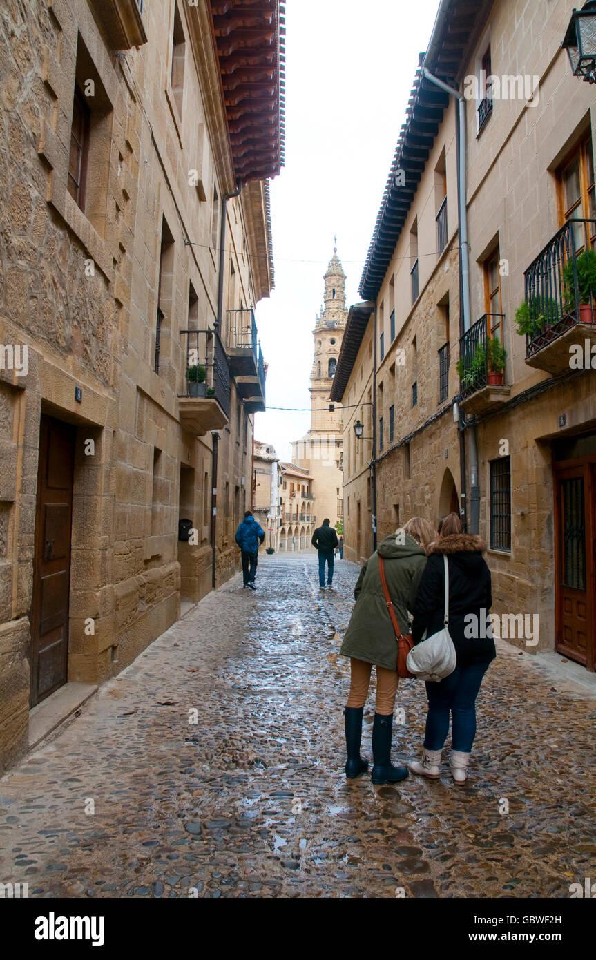 Tourists walking along a street. Briones, La Rioja, Spain. Stock Photo