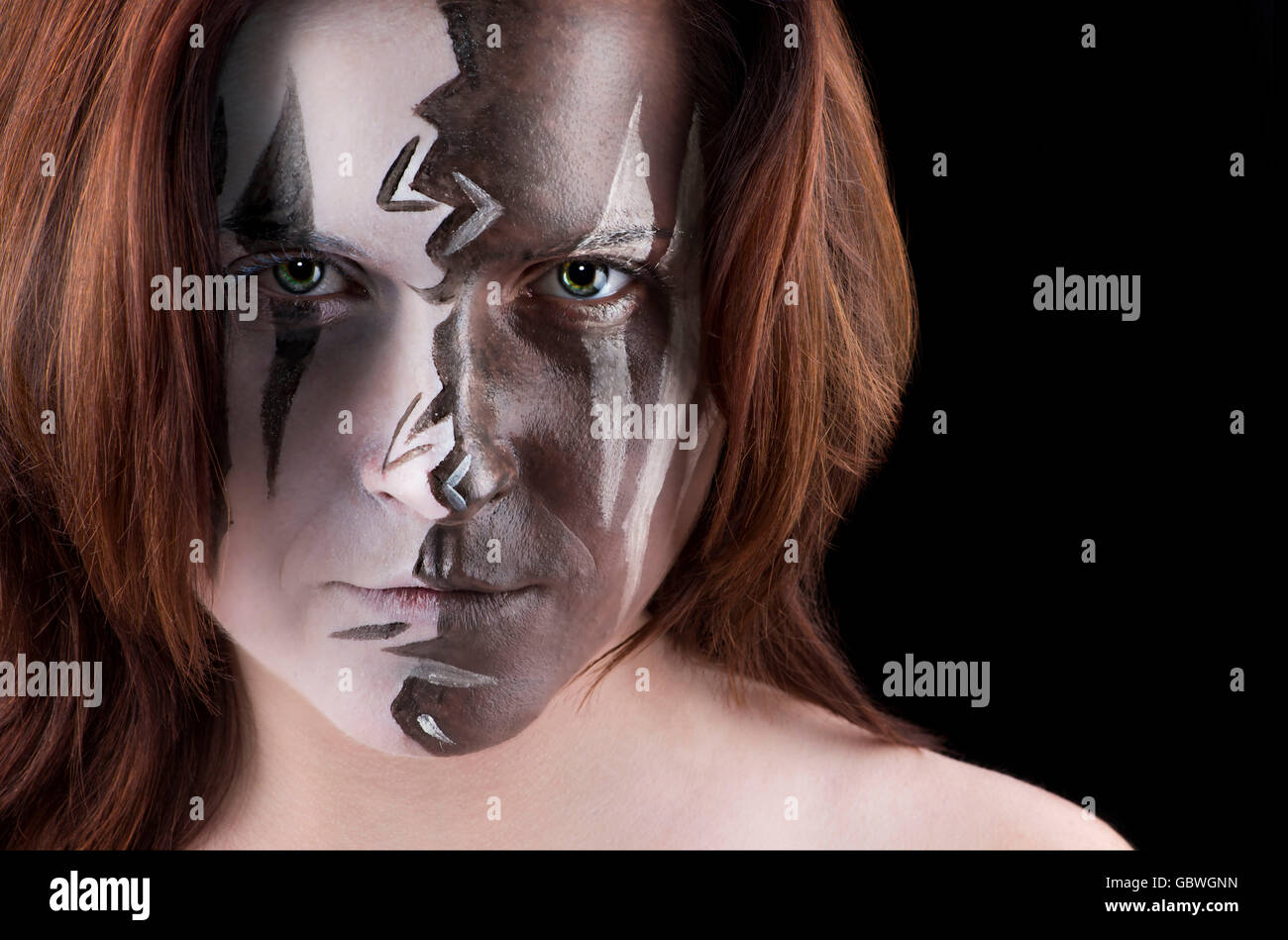 Portrait with face of woman with wild paint on it. - Stock Image