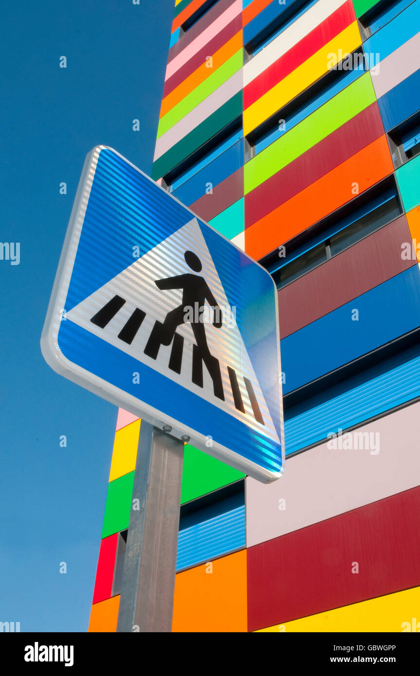 Pedestrian crossing signal and Colorines building. PAU Carabanchel, Madrid, Spain. Stock Photo