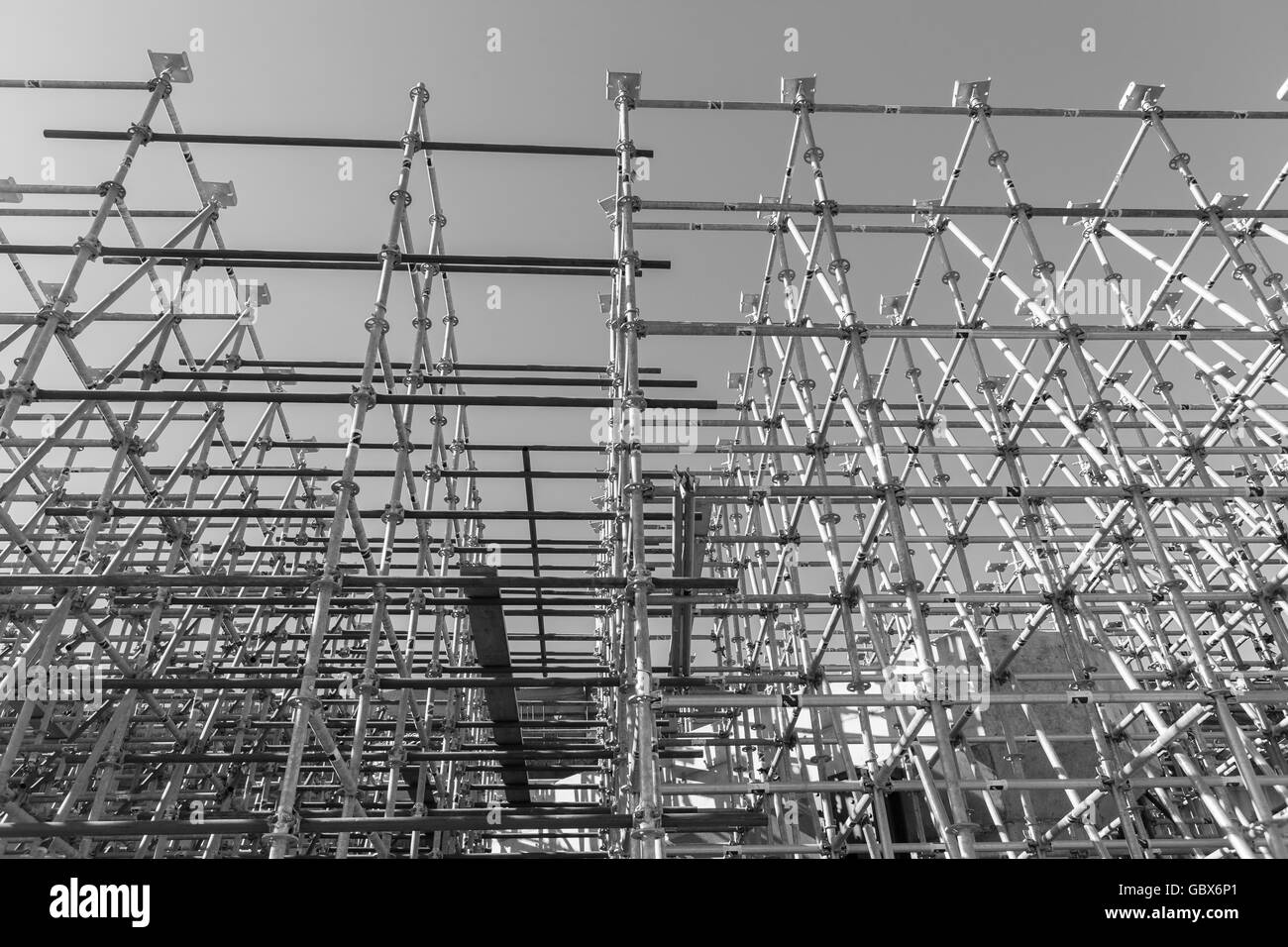 Construction steel scaffolding on building site closeup photo detail. - Stock Image
