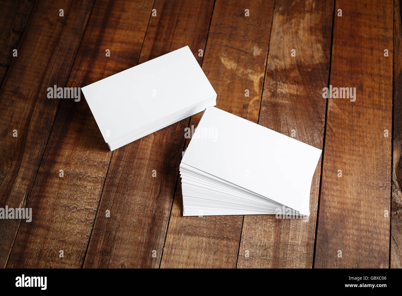 photo of blank business cards on vintage wooden table background