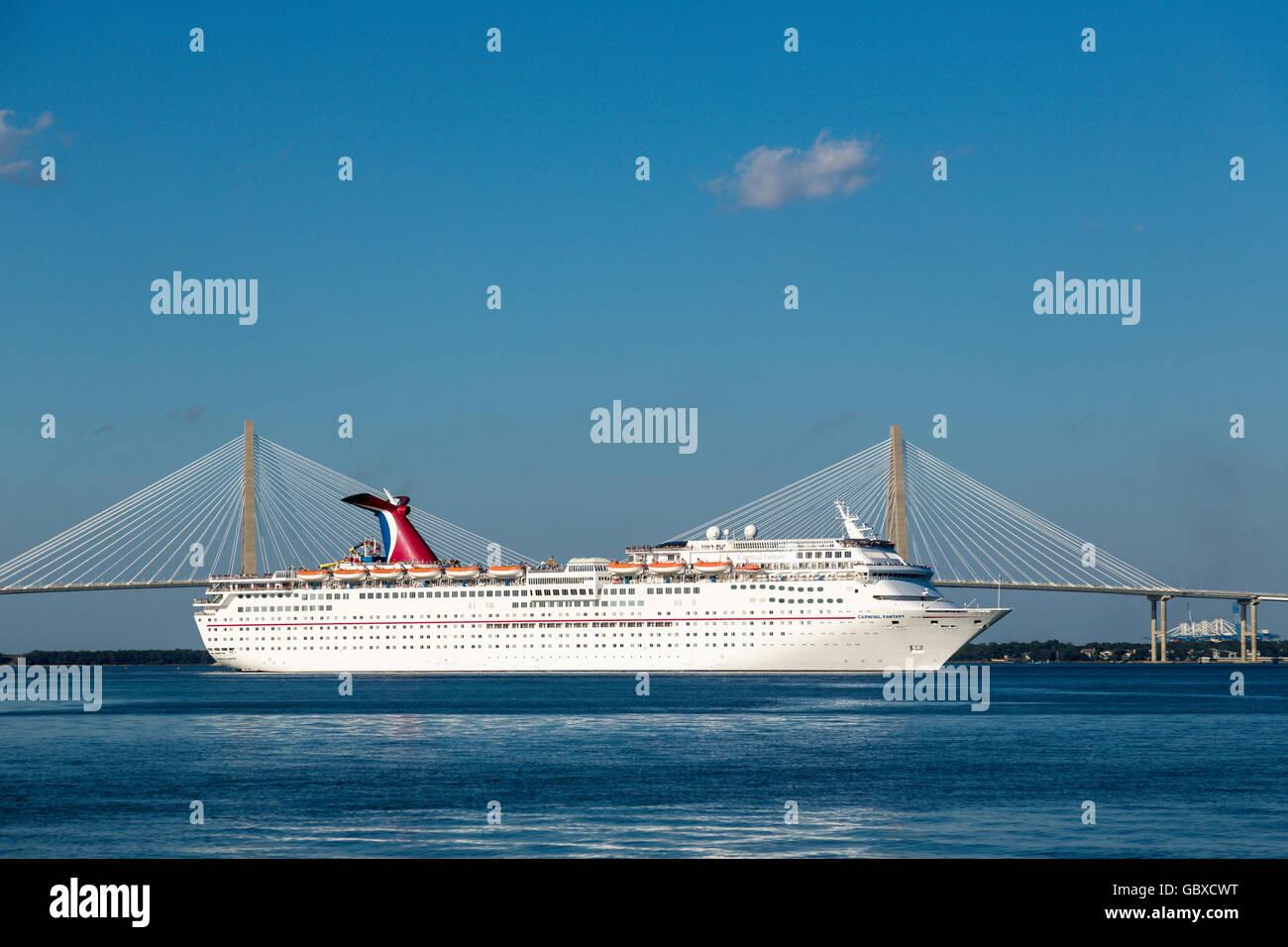 Cruise ship departs Charleston near Arthur Ravenel Jr bridge , SC, USA - Stock Image