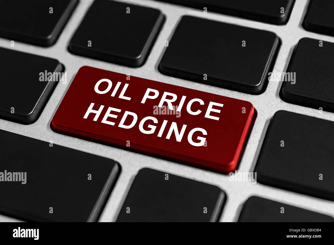 oil price hedging button on keyboard, business concept - Stock Image