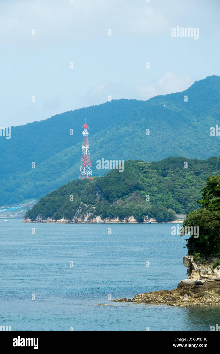 Power transmission tower on Hoso Island in the Seto Inland Sea. - Stock Image
