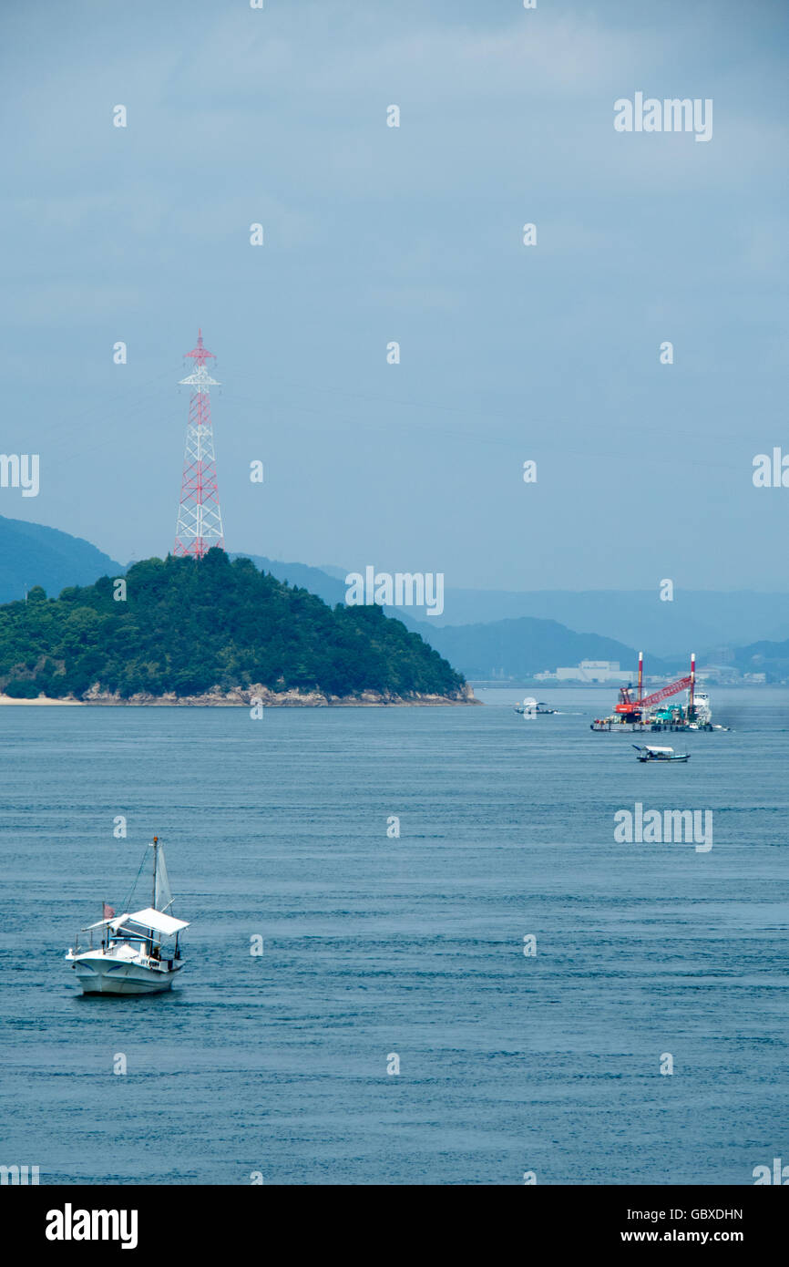 Small traditional Japanese fishing boats in the Seto Inland Sea. - Stock Image