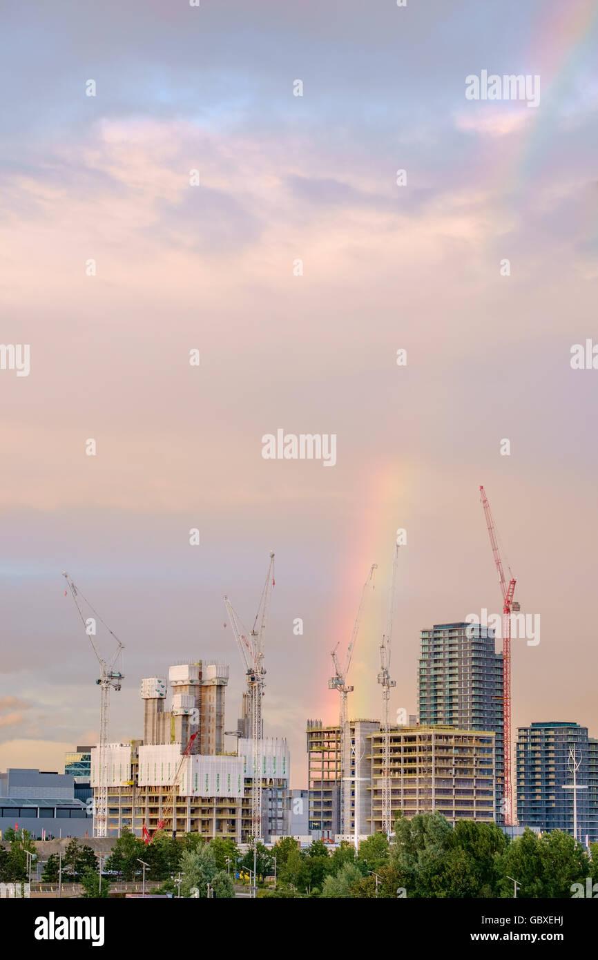 Rainbow over the new International Quarter, Olympic Park, Stratford, London UK. July 2016 Stock Photo