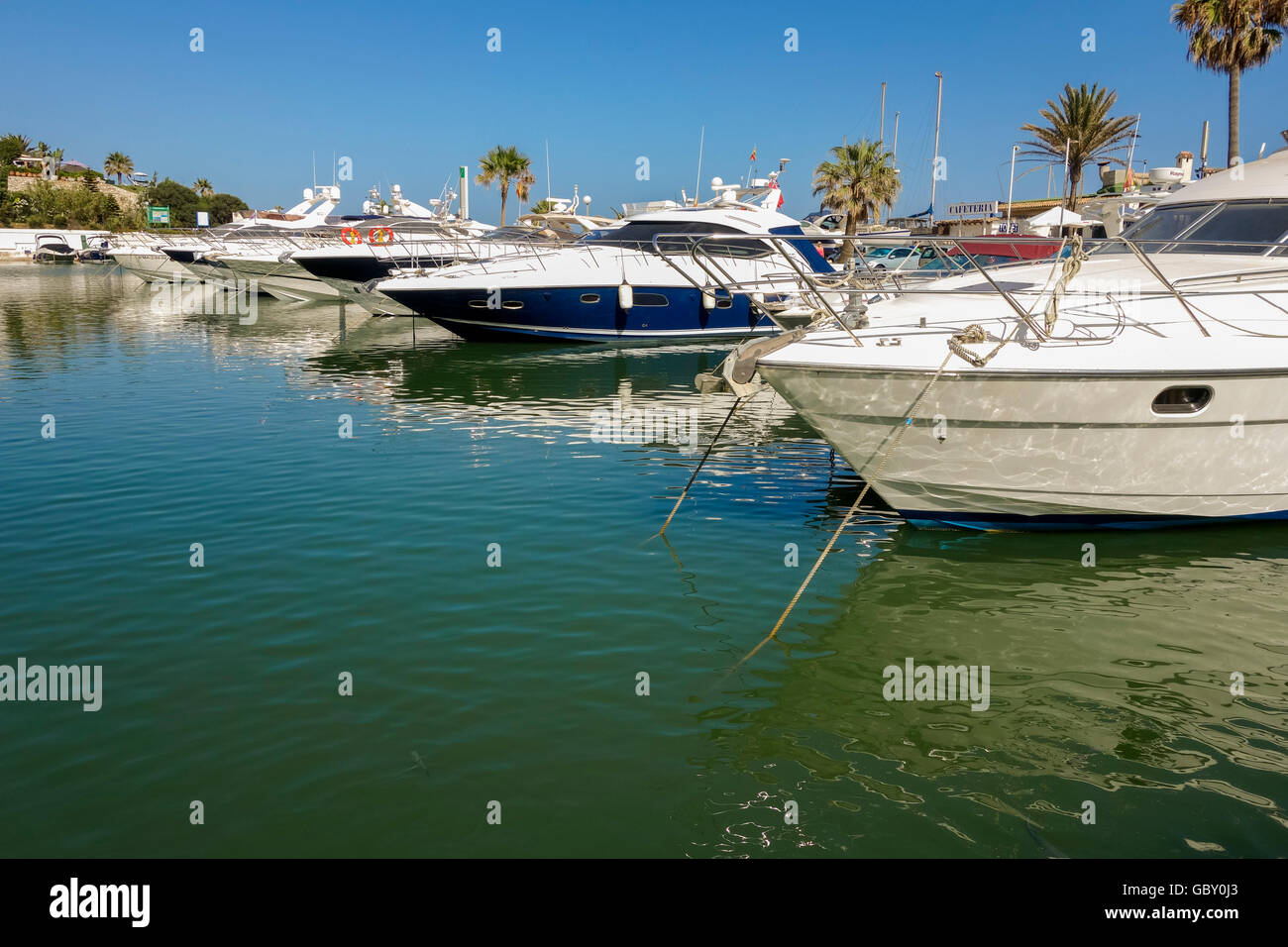 Yachts moored in Mediterranean style marina of Cabopino, Andalusia, Spain. Stock Photo