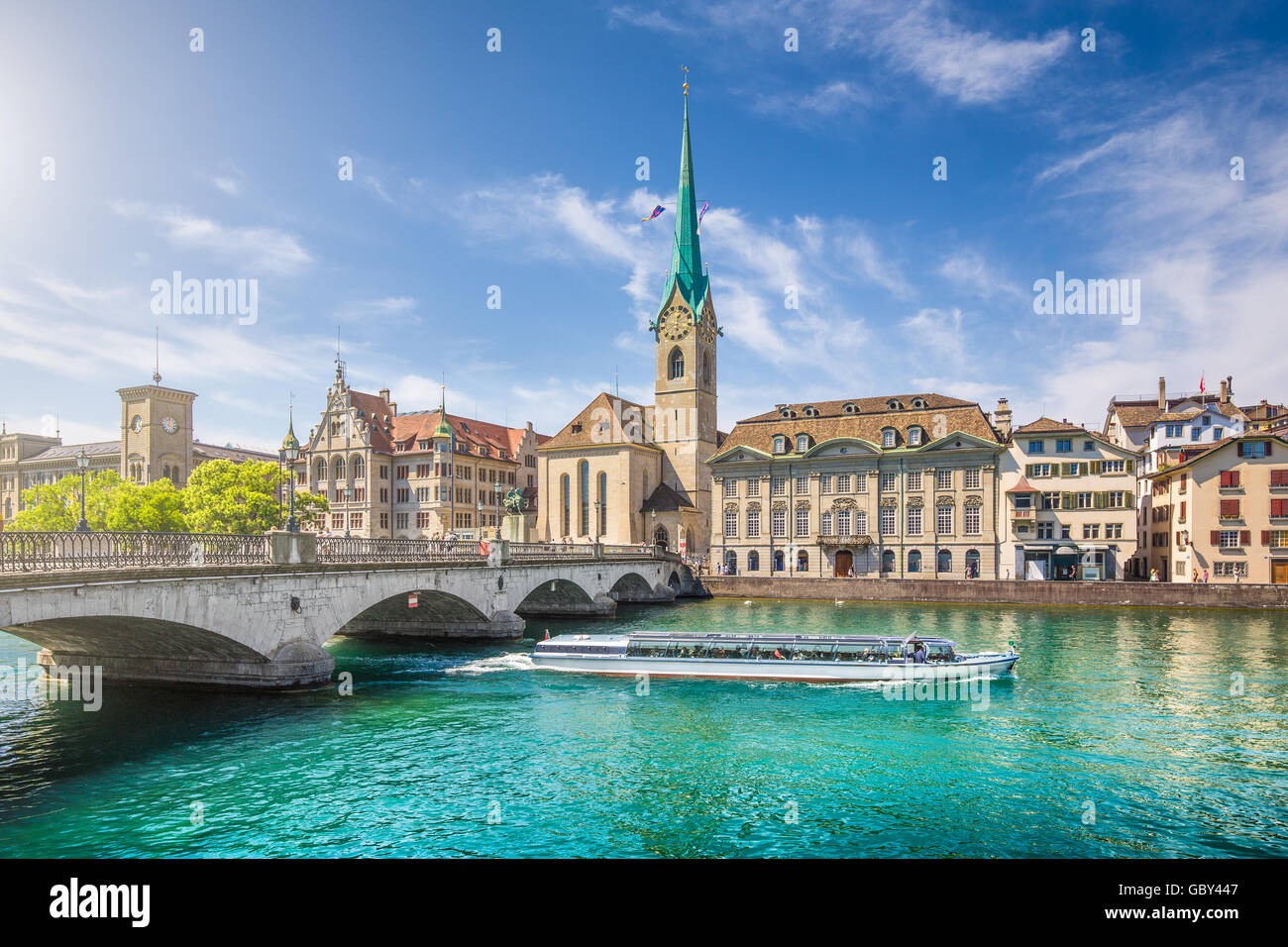 Historic city center of Zurich with famous Fraumunster Church and excursion boat on river Limmat, Canton of Zurich, - Stock Image