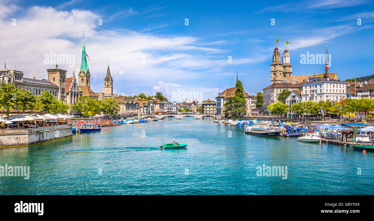 Panoramic view of historic Zurich city center with famous Fraumunster and Grossmunster Churches and river Limmat - Stock Image