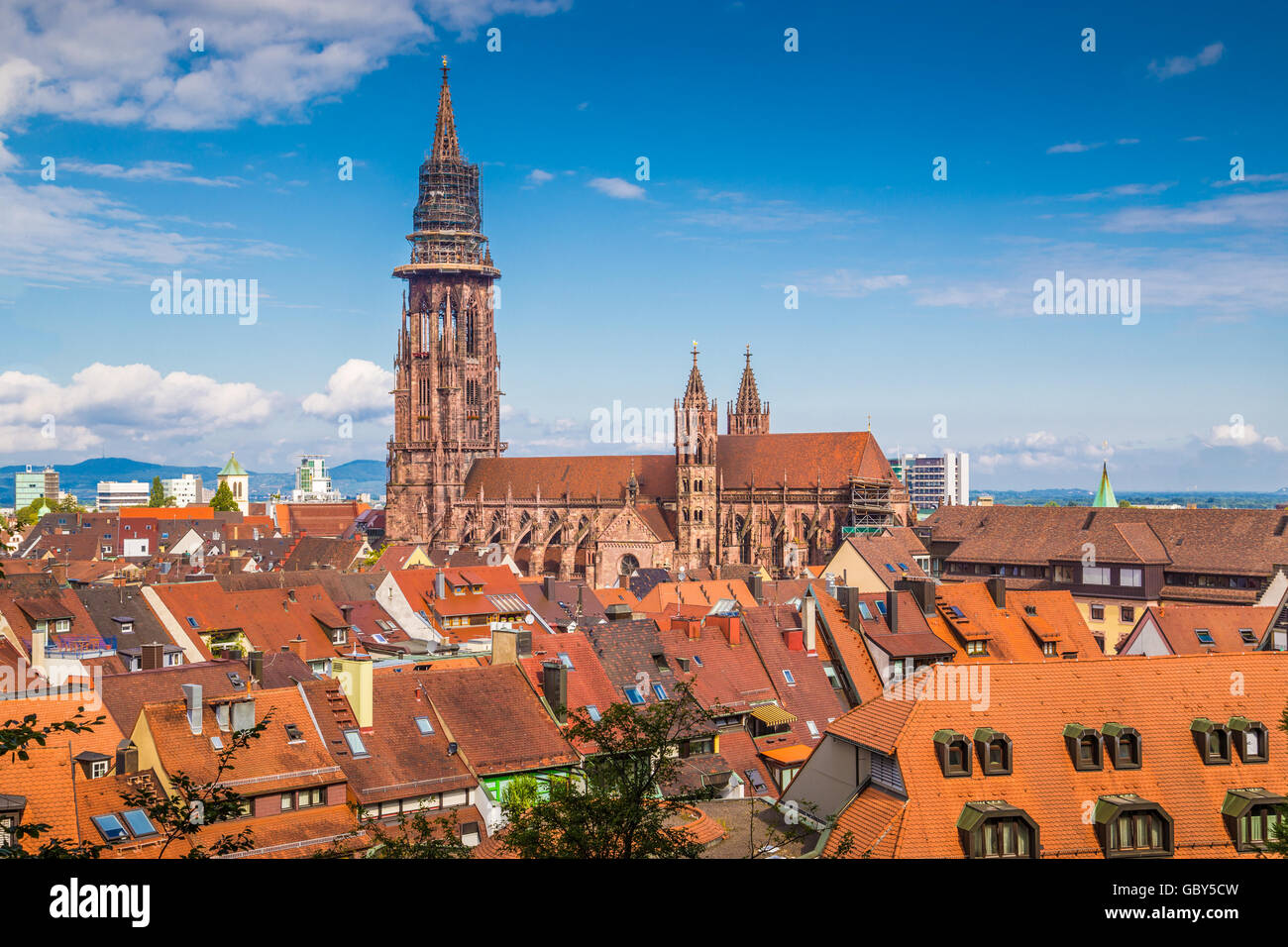 Historic town of Freiburg im Breisgau with famous Freiburg Minster cathedral in summer, Baden-Wurttemberg, Germany - Stock Image
