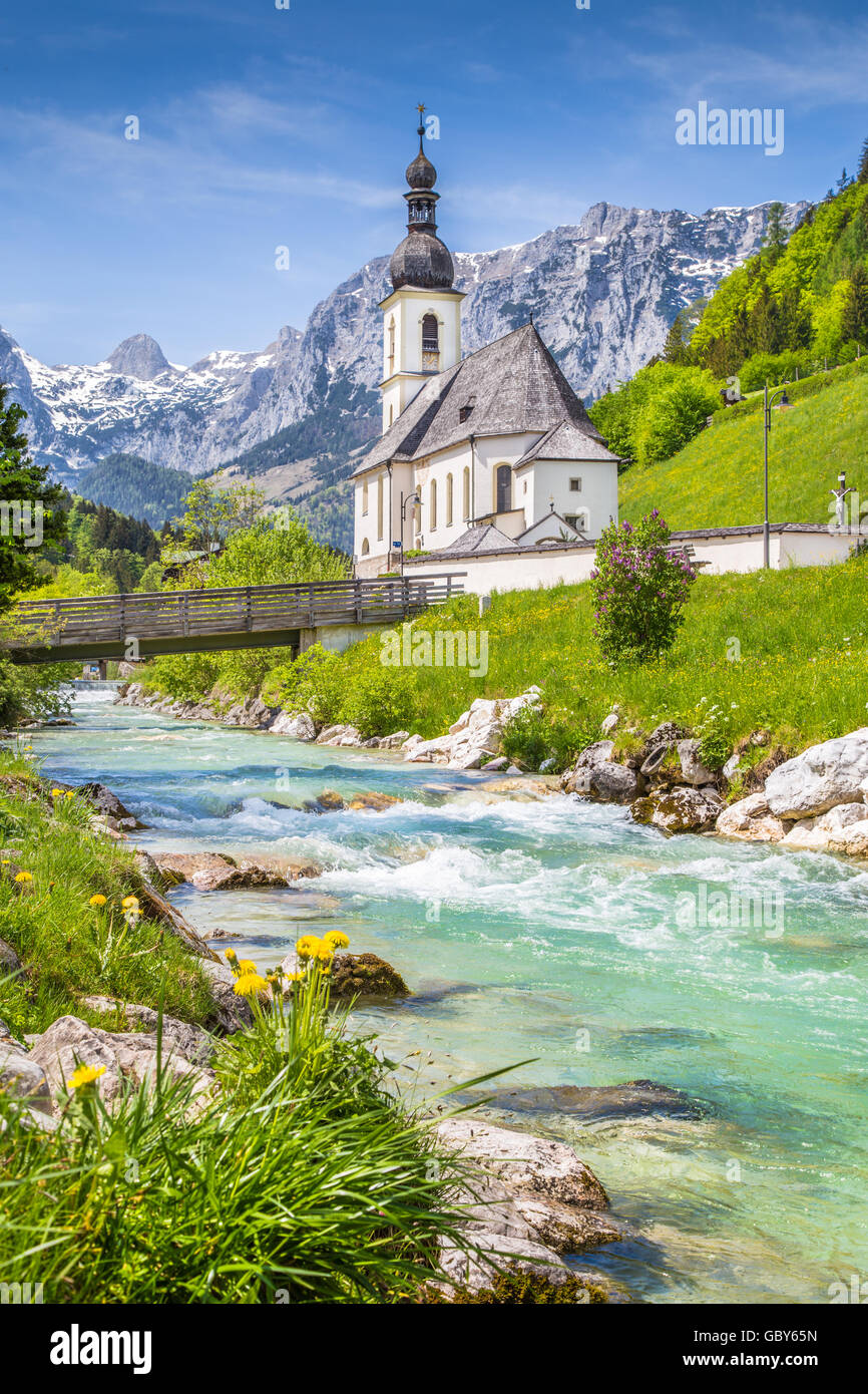 Scenic mountain landscape in the Bavarian Alps with famous Parish Church of St. Sebastian in the village of Ramsau Stock Photo