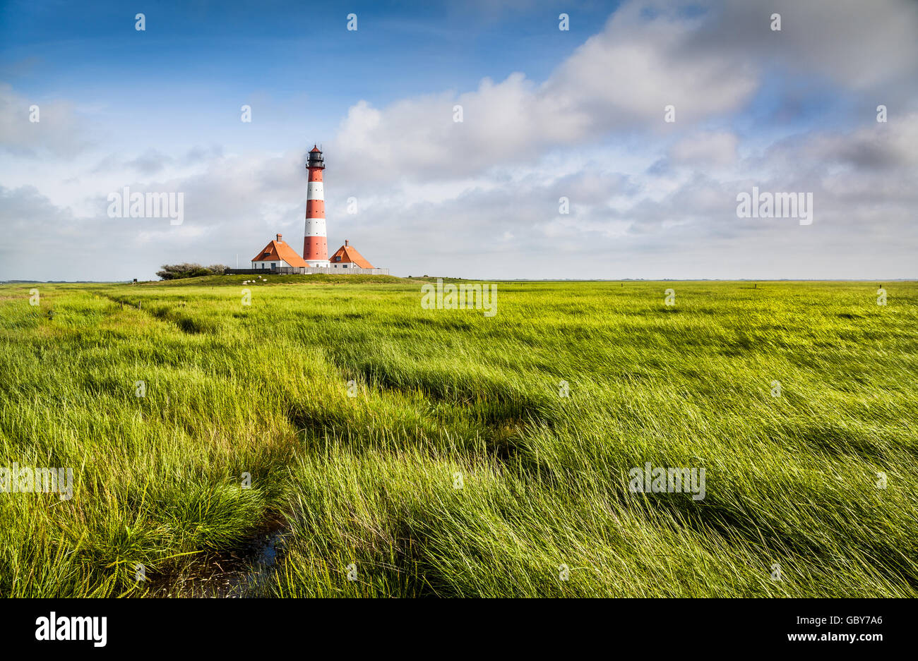Famous Westerheversand lighthouse in the background at North Sea in Nordfriesland, Schleswig-Holstein, Germany - Stock Image