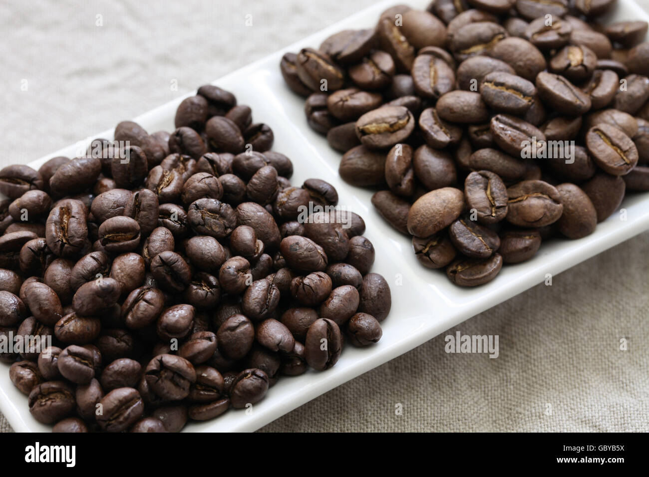 roasted coffee beans, peaberry and flat bean - Stock Image