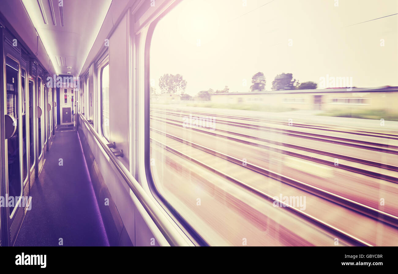 Vintage toned train window with motion blurred rails outside. - Stock Image