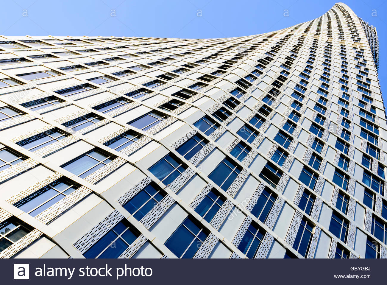 Cayan Tower, known as Infinity Tower is a 306-metre-tall (1,004 ft), 73-story skyscraper in Dubai, United Arab Emirates - Stock Image