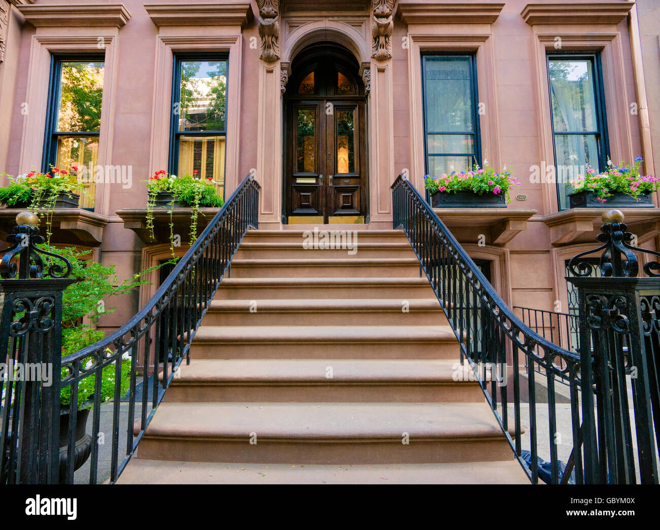 Lovely Brownstone Building With Wrought Iron Banister In