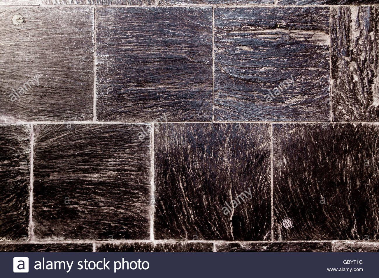 Rough Tile Floor With Black Slate And Joint Marks