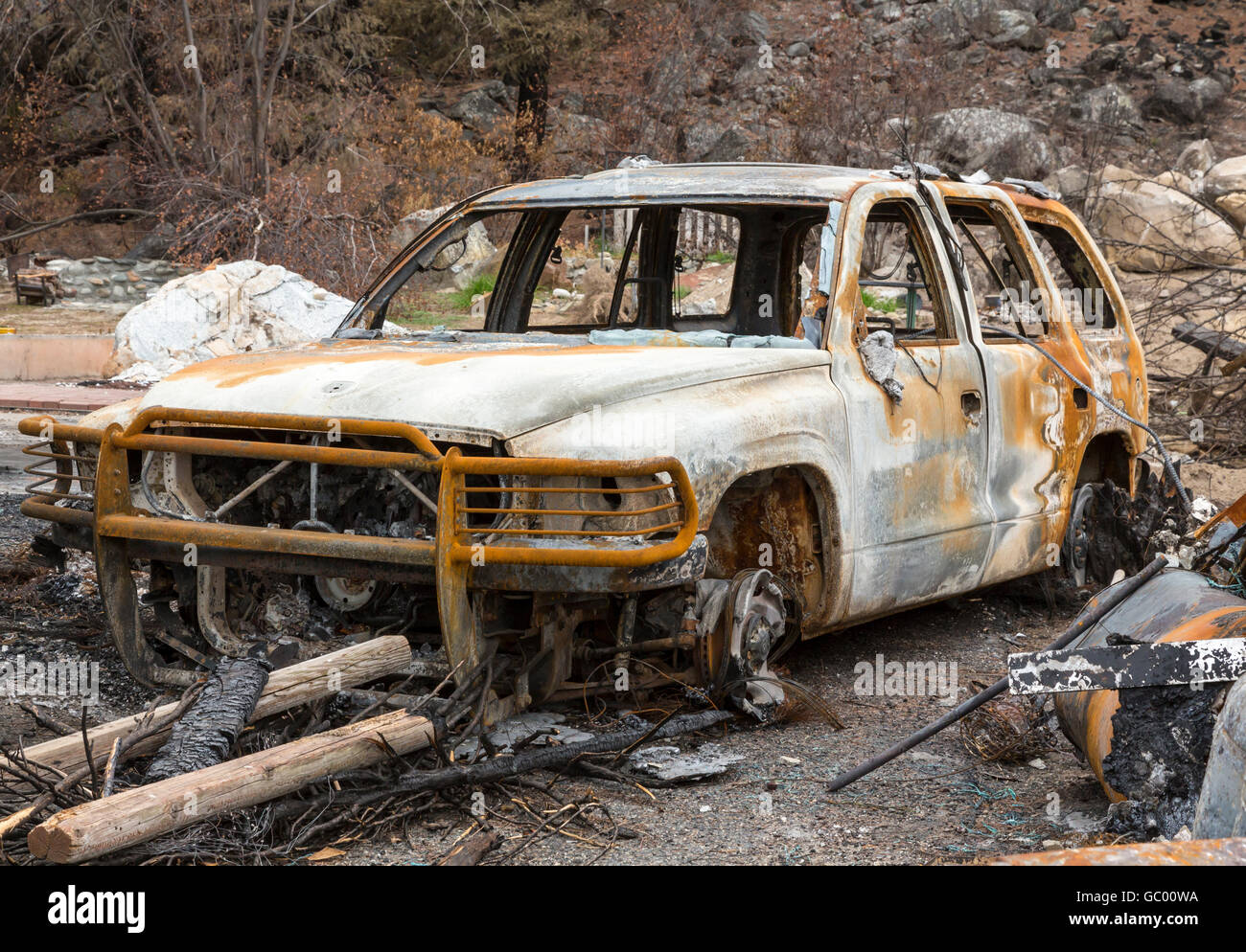Burned automobile after a natural disaster wildfire. Personal property destroyed in a forest fire. - Stock Image