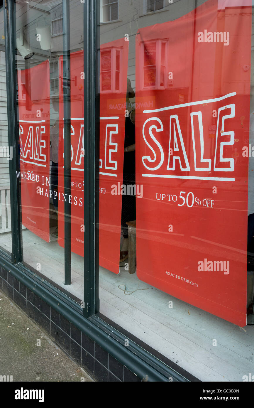 Hight street sales / retail sales / consumer confidence concept. Half-price sign.  Price reductions. - Stock Image