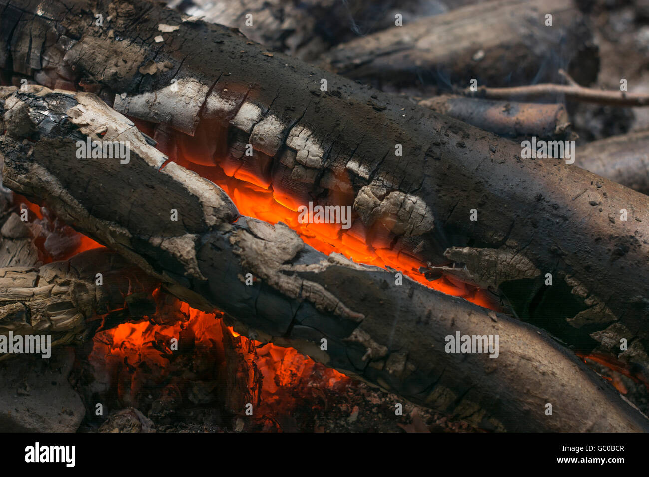 Glowing wood fire for concept of survival, bushcraft and camping. Fire concept. - Stock Image