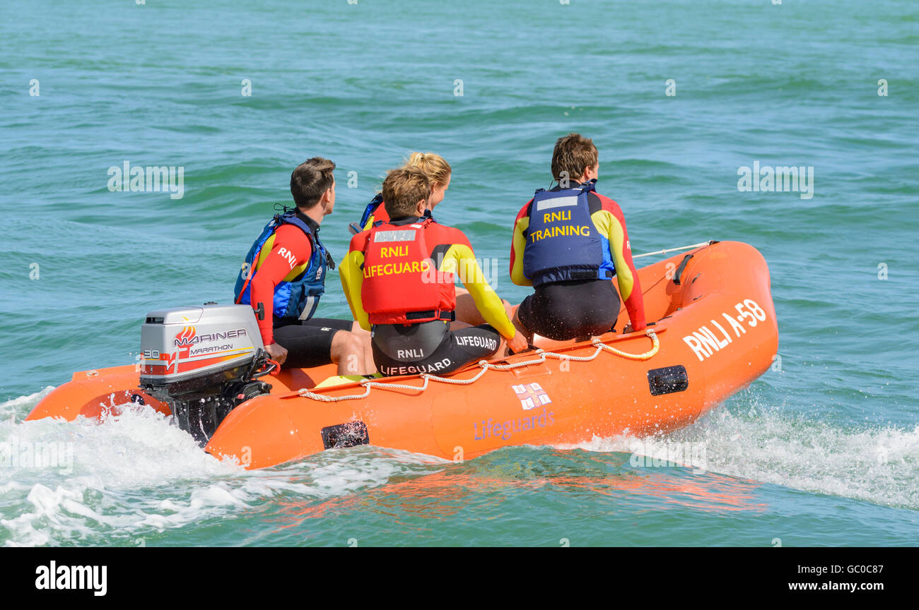 RNLI Arancia A-58 inflatable insure rescue boat lifeguard training on the sea near Littlehampton Beach, West Sussex, - Stock Image