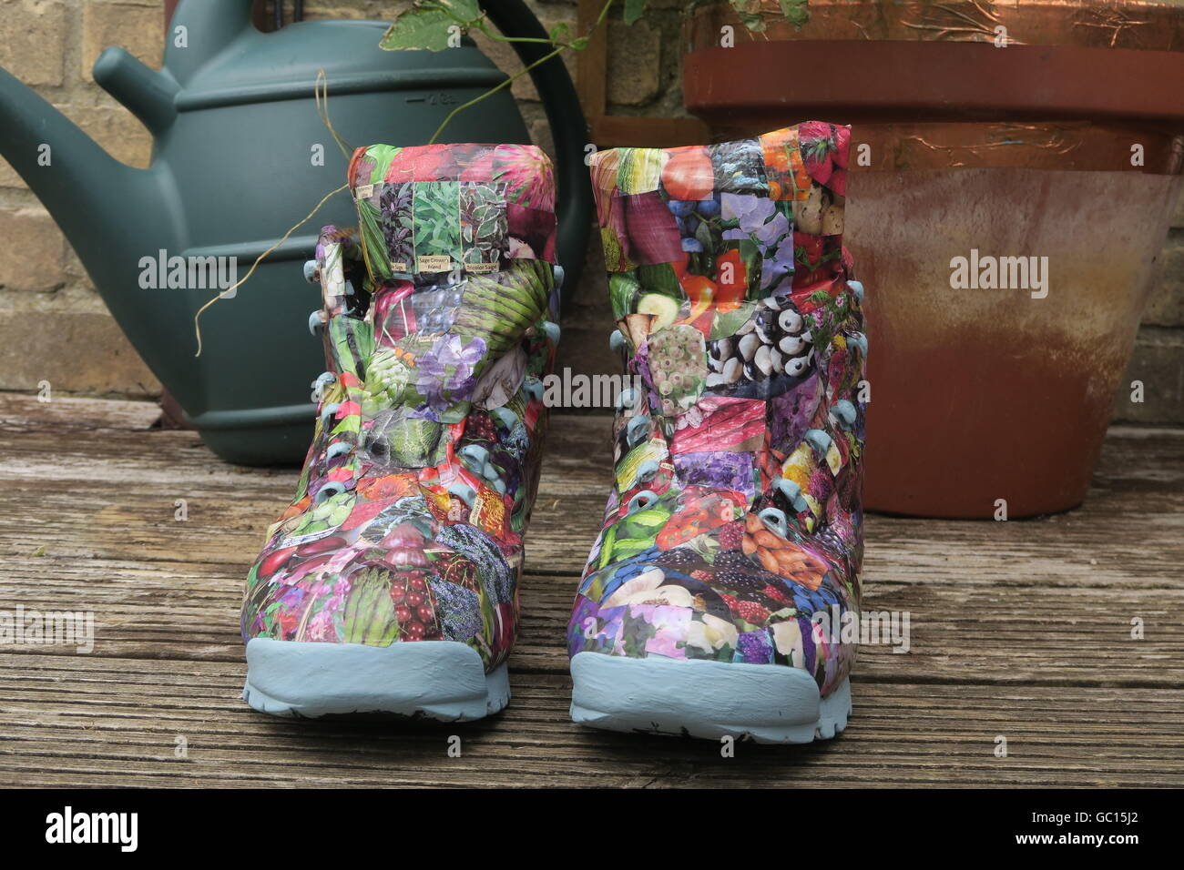 Re-imagined walking boots, decorated using decoupage. Stock Photo