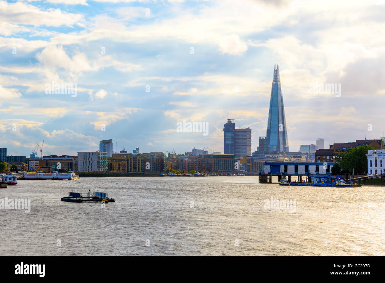 London cityscape with rays of sunlight shining through clouds - Stock Image