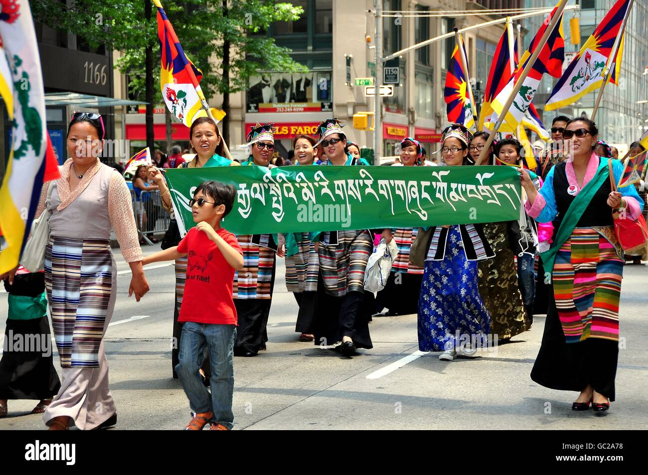 New York City:   Tibetans marching in the International Immigrants Foundation Parade on Avenue of the Americas - Stock Image