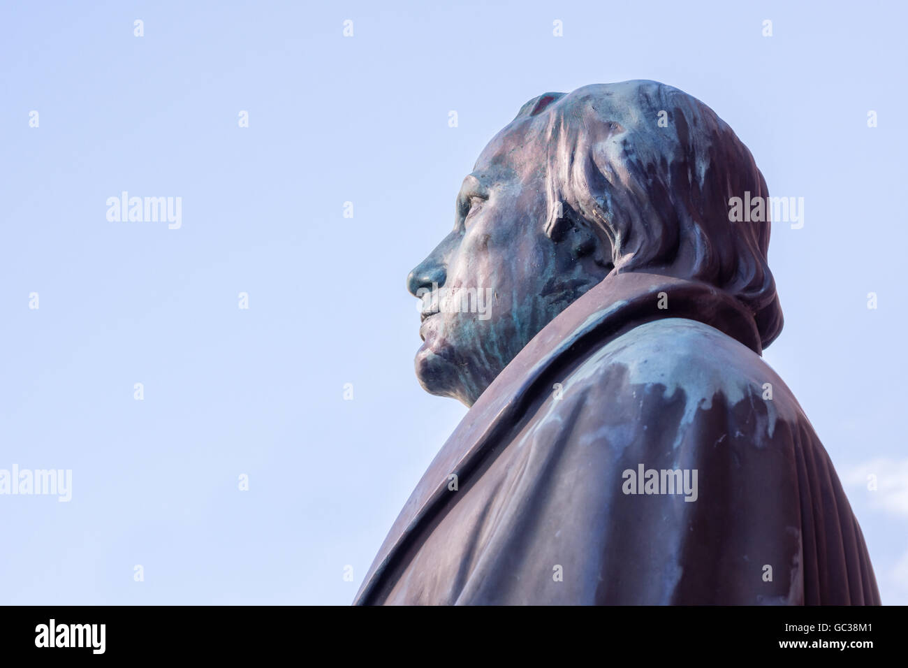 Bronze statue of tre german reformer Martin Luther with space for texts on the blue sky. - Stock Image