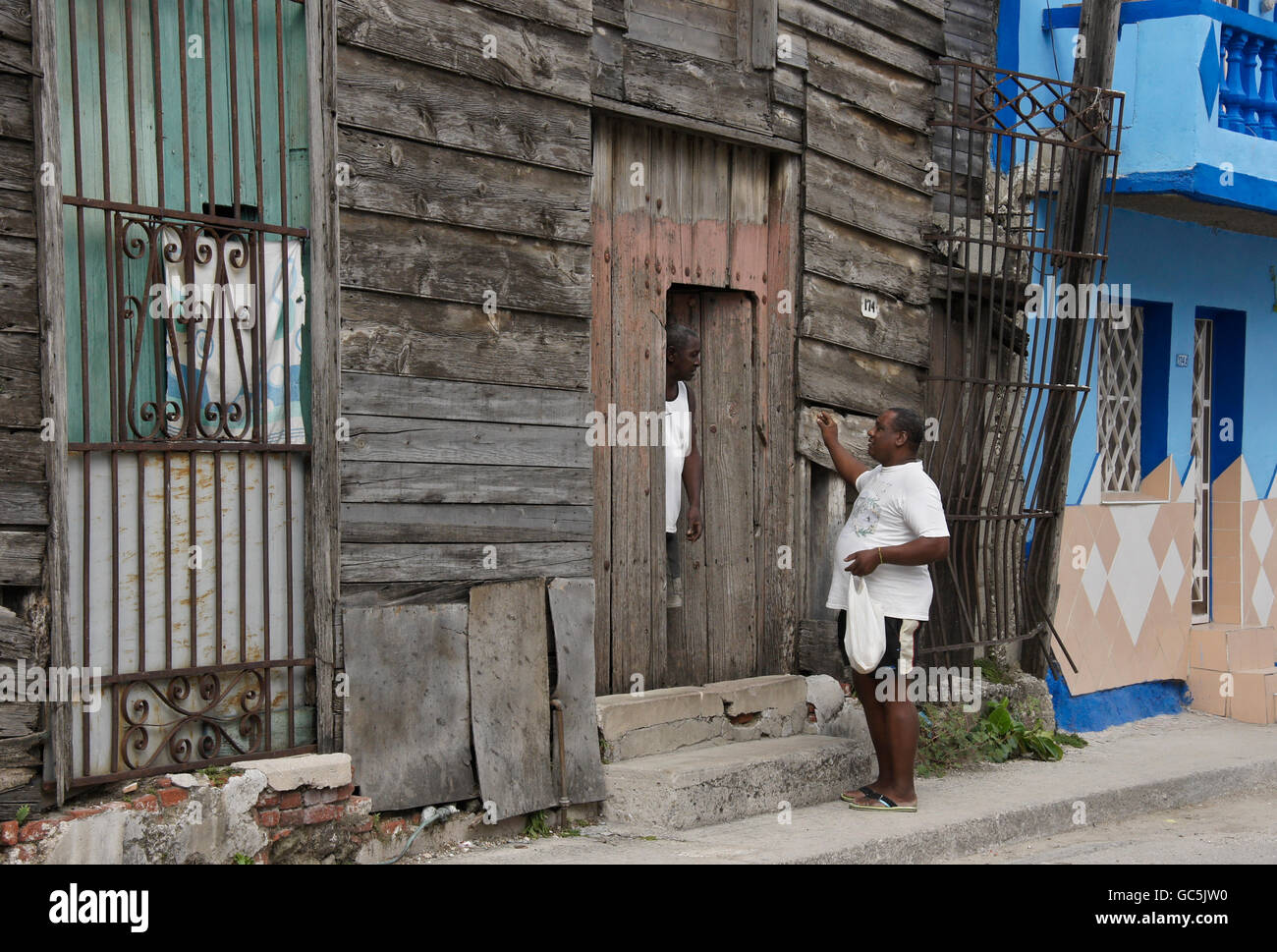 Two homes in Regla, Cuba, one in disrepair, one renovated and well maintained - Stock Image
