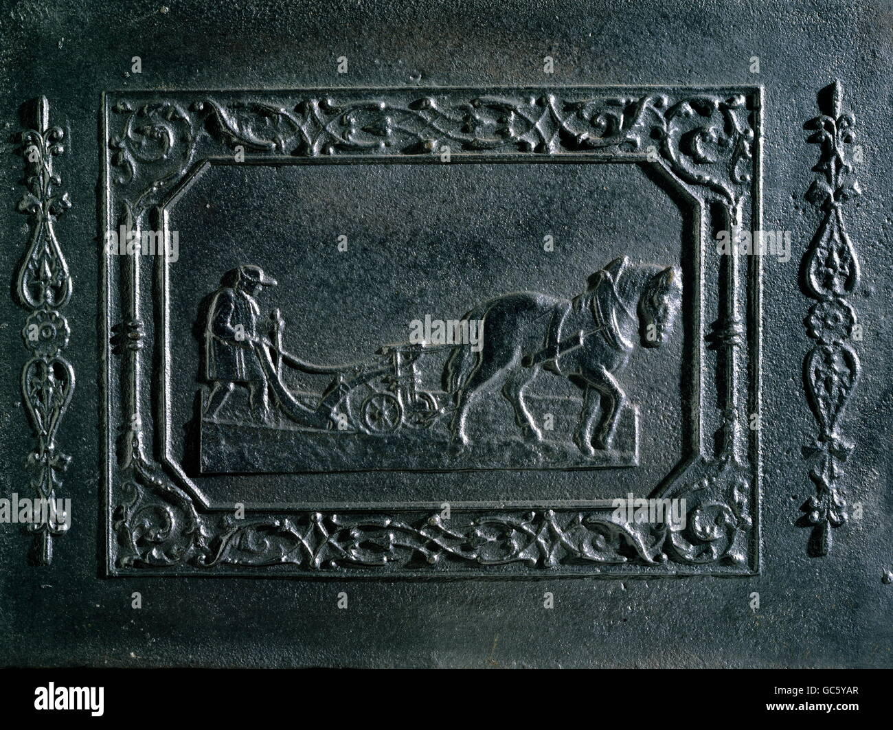 agriculture, farming, ploughing, farmer with plough, relief, cast iron, ironworks of Prince Bishop, Obereichstaett, - Stock Image